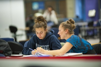 Student tutoring at the Q Center at the Homer Babbidge Library