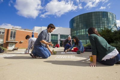 Students chalking sidewalks at School of Fine Arts, 2012