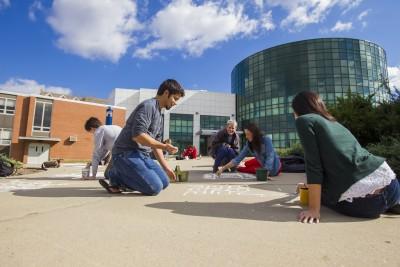Students chalking sidewalks at School of Fine Arts, 2012